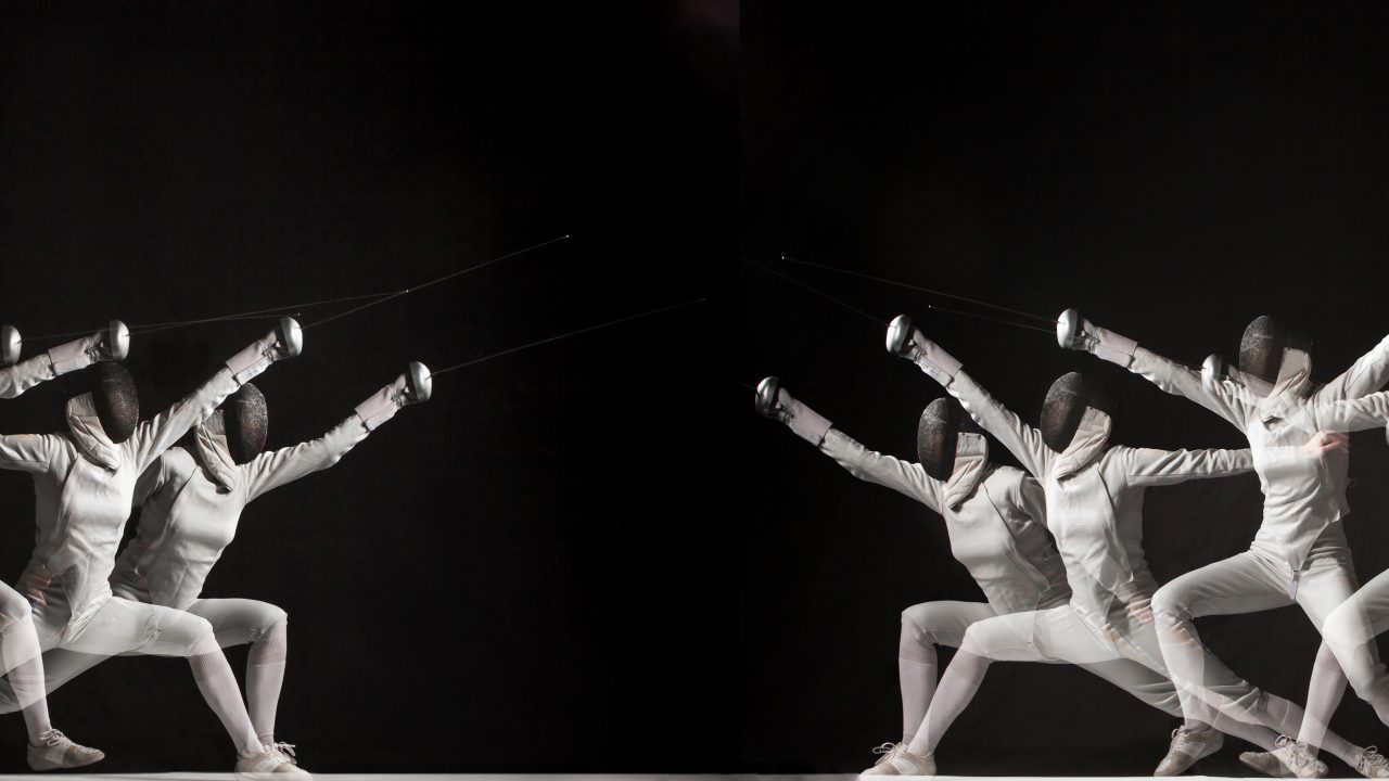 Duel fencers on a black background. collage of photos taken